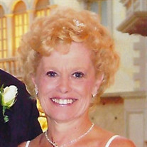 Linda J West