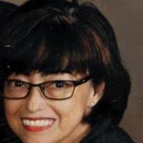 Mrs. Gina E. Tawzer