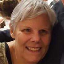 Kristine M. De Broux