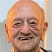 John F. Van Veelen