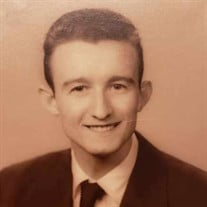 John E. Mirgaux