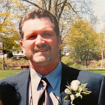 John E. Malier