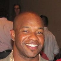 Derrick J Carson