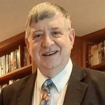 Norman E. Dellas Jr.