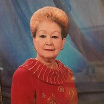 Gladys E Bello