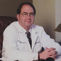 Glenn E. Lambert, Jr., M.D.