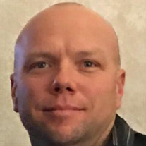 Adam L. Devlaminck