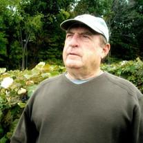 GEORGE L. MACEK