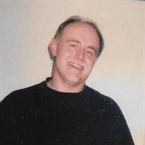 Dennis L. Huge