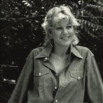 Catherine H Wrigley