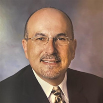 Dr. Larry J Macaluso
