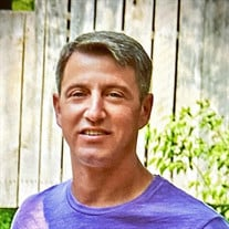 Travis Adam Karlie