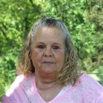 Mrs. Nevada Jean Kirby of Henderson, TN